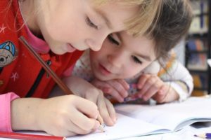 Kids with hearing loss in a classroom