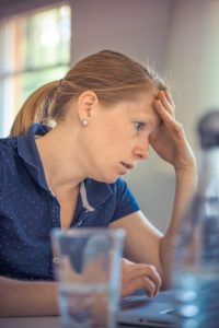 Woman looking worried at her desk